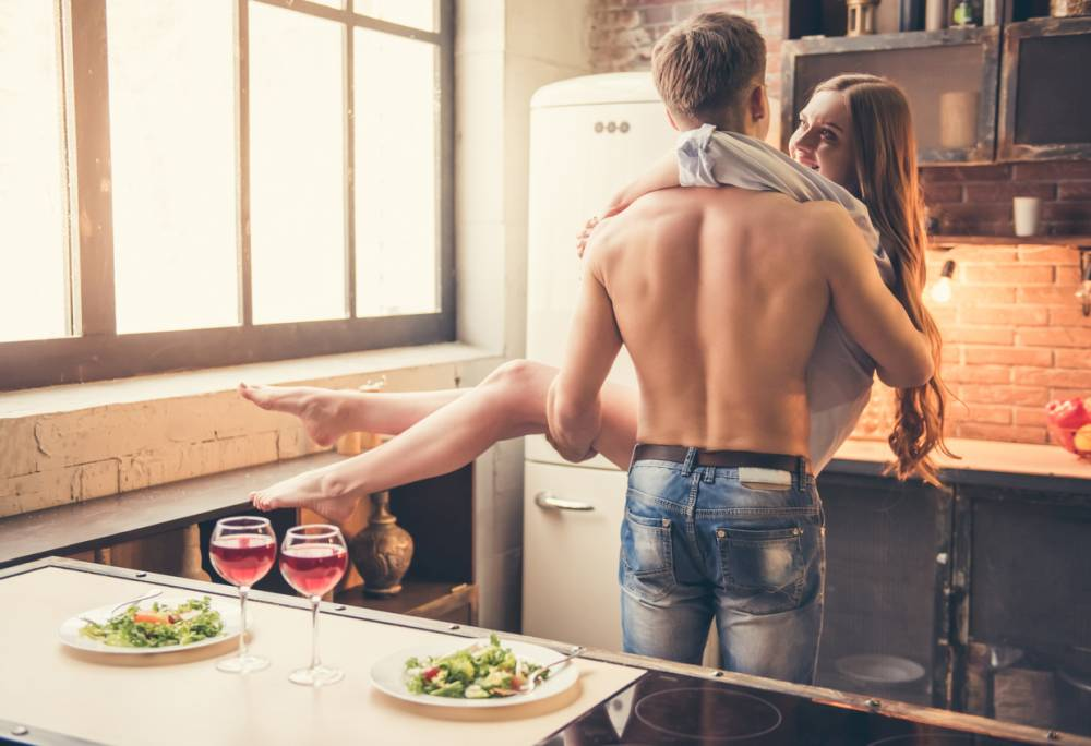 Beautiful couple in the kitchen