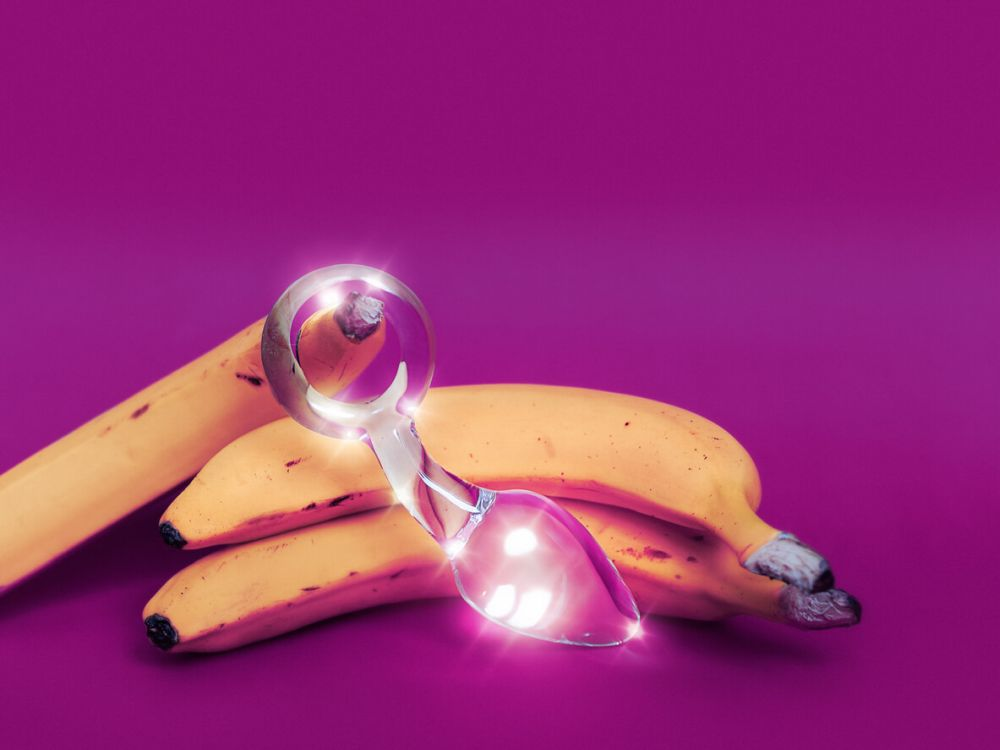 Glass sex toy and a yellow banana
